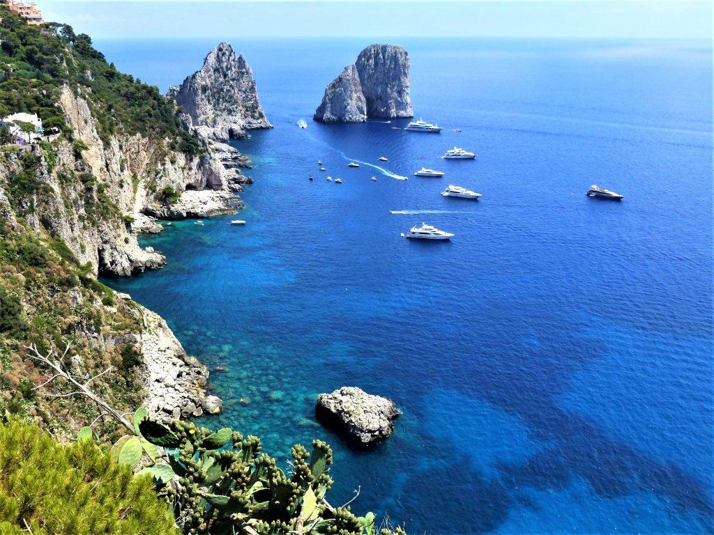Faraglioni rock formations in the blue sea of Capri Island Italy. Blue Fever