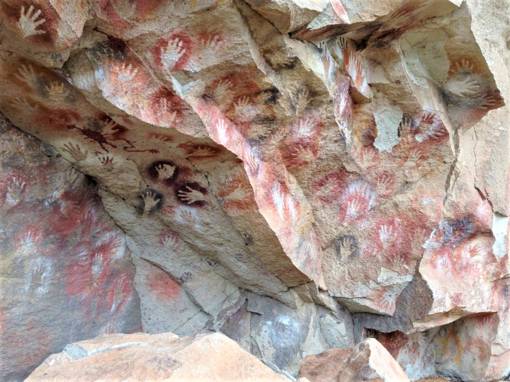 Prehistoric hand prints on cave walls
