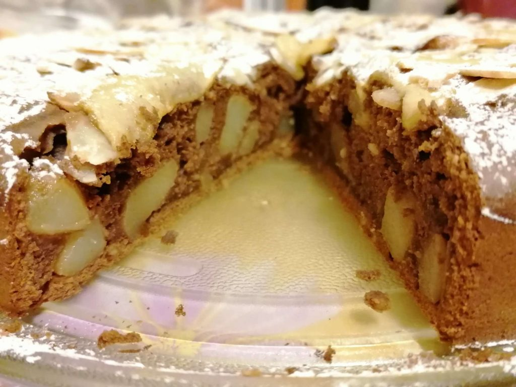 cut pear and almond chocolate  cake on a plateau