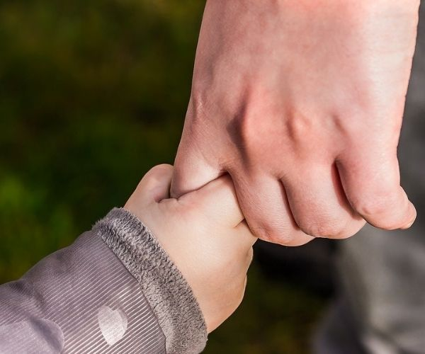 adult holding baby's hand love
