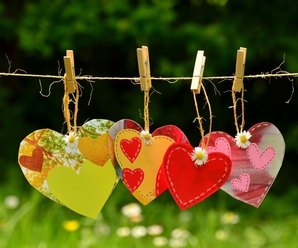 paper hearts hanged on washing line activities for Valentine's day