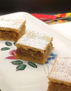 squares of pumpkin cake with creamy filling